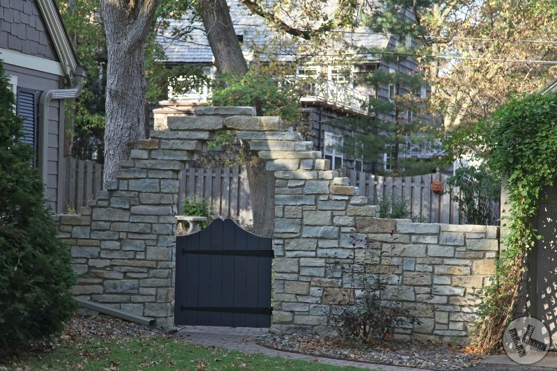 AFTER: Stone Wall with Custom Designed Wood Gate (Edina, MN)