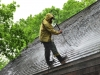 Man Washing a Cedar Roof in Minnesota by Kuhl's Contracting