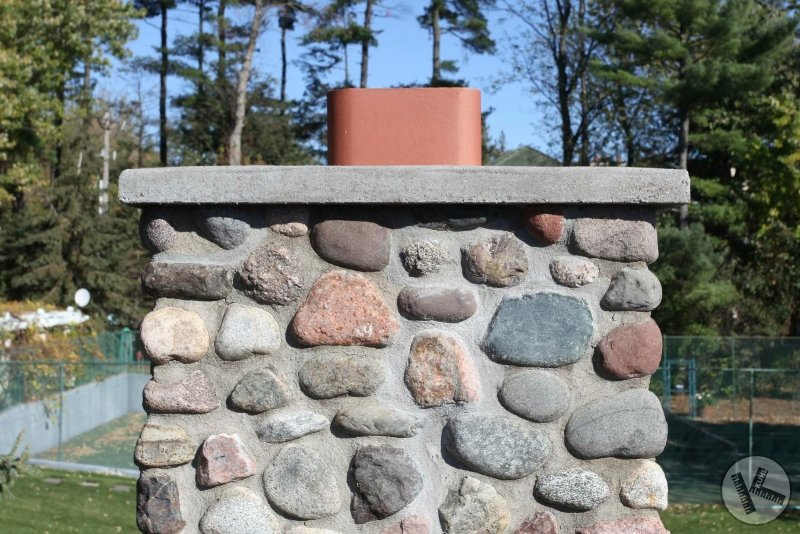 AFTER: Close-up, Fieldstone Chimney Repair with New Flashing (Excelsior, MN)