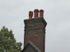 Brick Chimney Rebuilt with New Chimney Pots in Minneapolis