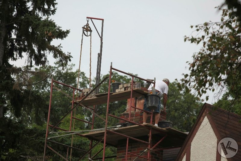 Man Working on Scaffolding Fixing Chimney in Edina