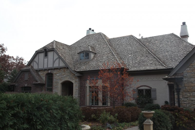 Storm damaged cedar roof replacement Wayzata before