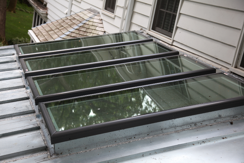 New skylights and metal roof in Edina after skylight replacement