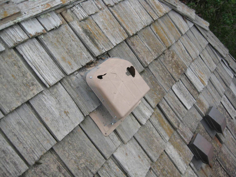 Wood roof with hail damage in Minneapolis
