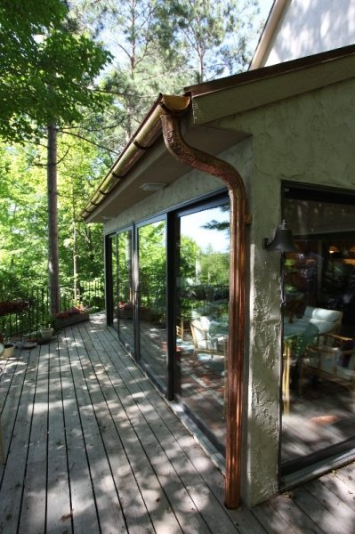 new-copper-gutters-with-copper-downspouts
