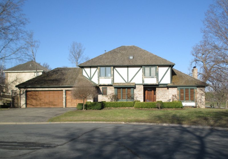 wood roof replacement lifespan in woodland lake minnetonka area before